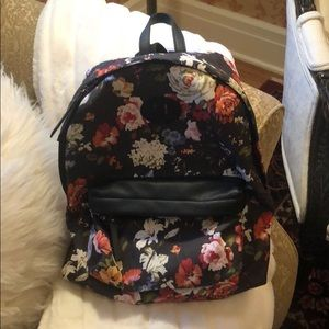Steve Madden floral backpack with striped lining